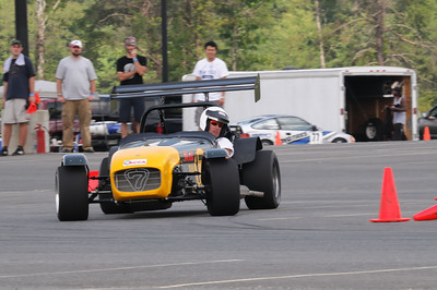Kenny Sorenson takes a turn in Danny Kao's Caterham.